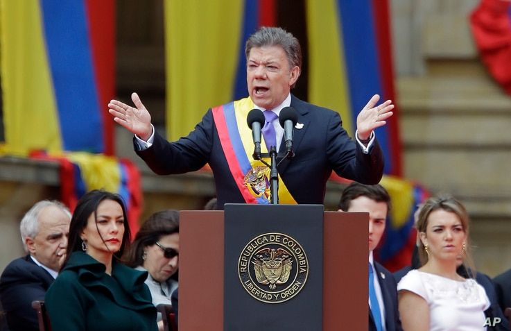 Wearing the presidential sash, newly sworn-in President Juan Manuel Santos, delivers his inaugural speech, in Bogota, Colombia, Aug. 7, 2014.