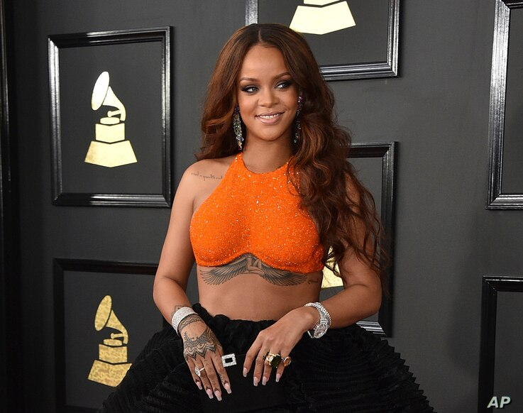 FILE -  Rihanna arrives at the 59th annual Grammy Awards in Los Angeles.