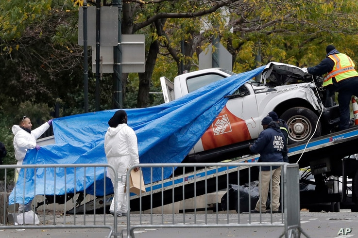 The truck used in the bike path attack is removed from the crime scene, Nov. 1, 2017, in New York.