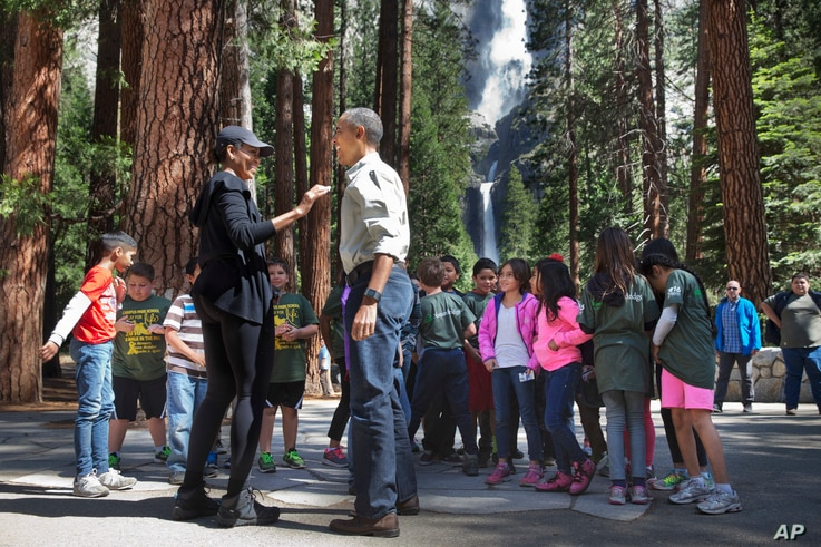 """First lady Michelle Obama and President Barack Obama meet with children during the """"Every Kid in a Park"""" event at Yosemite National Park, Calif., June 18, 2016. The Obama family traveled to Yosemite to celebrate the 100th anniversary of the creation ..."""