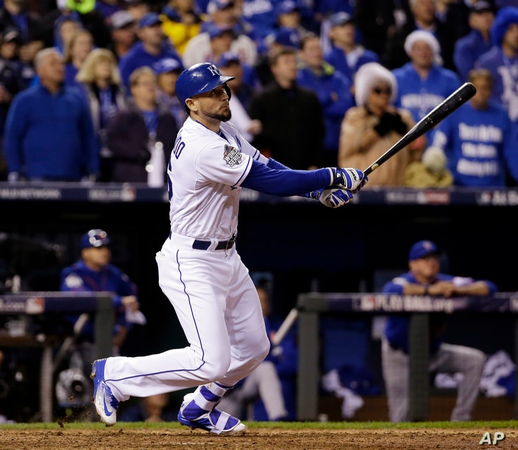 Kansas City Royals' Paulo Orlando flies out during the ninth inning of Game 1 of the Major League Baseball World Series against the New York Mets, Oct. 27, 2015, in Kansas City, Mo.