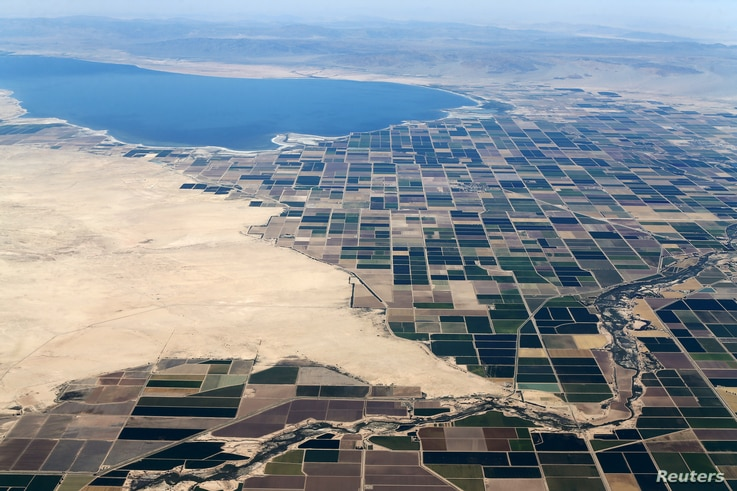 FILE - Agricultural farm land is shown near the Salton Sea and the town of Calipatria in California, United States.