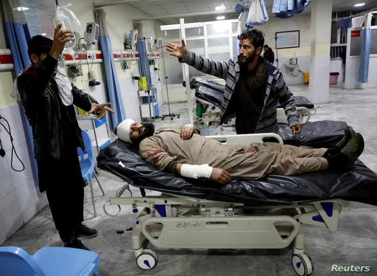 An Afghan injured man receives treatment at a hospital after a car bomb blast in Kabul, Afghanistan, Jan. 14, 2019.