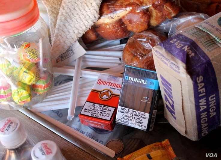 The Tobacco Control Bill would impose strict limits on marketing tobacco, and bans displaying it in shops, July 4, 2014. (H. Heuler/VOA News)