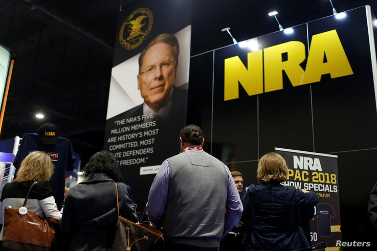 People sign up at the booth for the National Rifle Association at the Conservative Political Action Conference at National Harbor, Maryland, Feb. 23, 2018.