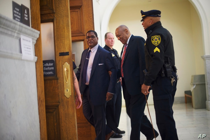Bill Cosby, second from right, arrives at the Montgomery County Courthouse for his sexual assault trial, June 7, 2017.