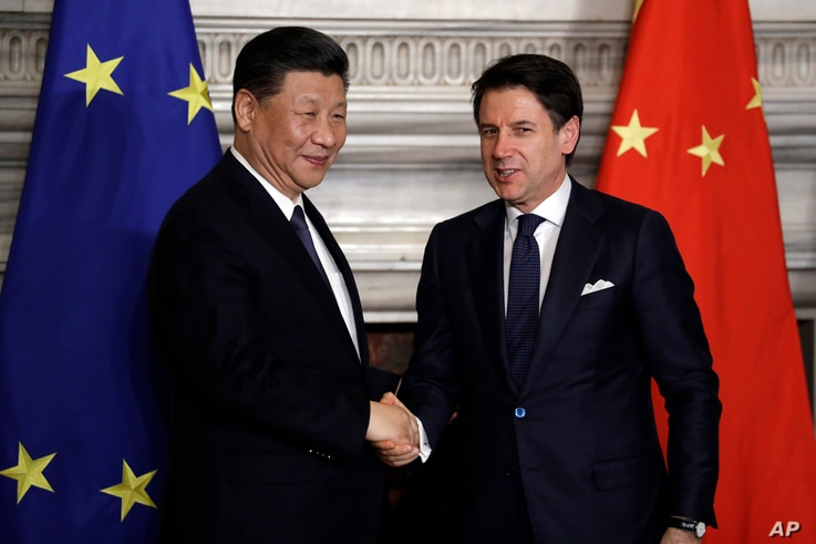 Chinese President Xi Jinping, left, and Italian Prime Minister Giuseppe Conte shake their hands following the signing of a memorandum in support of Beijing's 'Belt and Road' initiative, at Rome's Villa Madama, March 23, 2019.