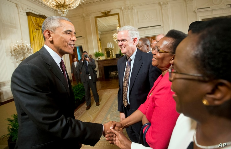 President Barack Obama shakes hands with guests after speaking during a reception in the East Room of the White House in Washington, July 22, 2015. The reception was to celebrate the recent signing into law of the African Growth and Opportunity Act (...