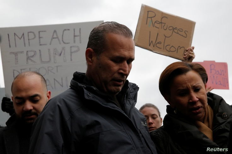 Iraqi immigrant Hameed Darwish stands with Congresswoman Nydia Velazquez, right, after being released at John F. Kennedy International Airport in Queens, New York, Jan, 28, 2017.