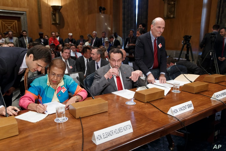 FILE - From left, Delegate Eleanor Holmes Norton, the District of Columbia's nonvoting delegate in the U.S. House; then-D.C. Mayor Vincent C. Gray; and D.C. Council Chairman Philip H. Mendelson, prepare to testify before a Senate panel on a D.C. stat...