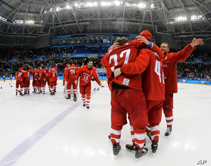 Olympic athletes from Russia celebrate after winning the men's gold medal hockey game against Germany, 4-3, in overtime at the 2018 Winter Olympics, Feb. 25, 2018, in Gangneung, South Korea.
