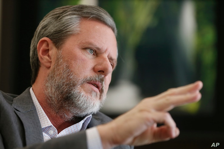 FILE - Liberty University President Jerry Falwell Jr. gestures during an interview in his offices at the school in Lynchburg, Va., Nov. 16, 2016.