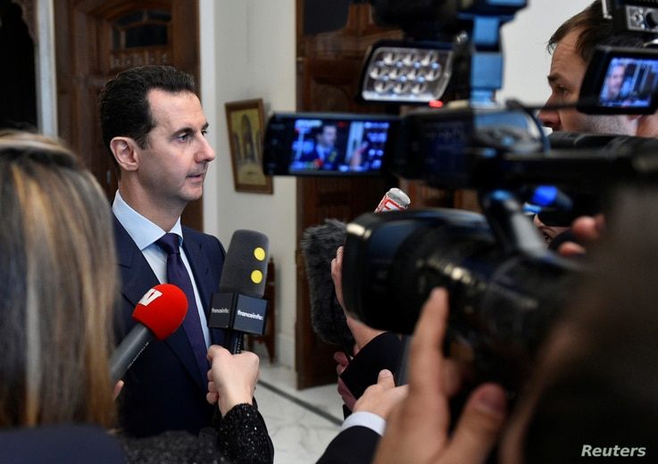 Syria's President Bashar al-Assad speaks to French journalists in Damascus, Syria, Jan. 9, 2017.
