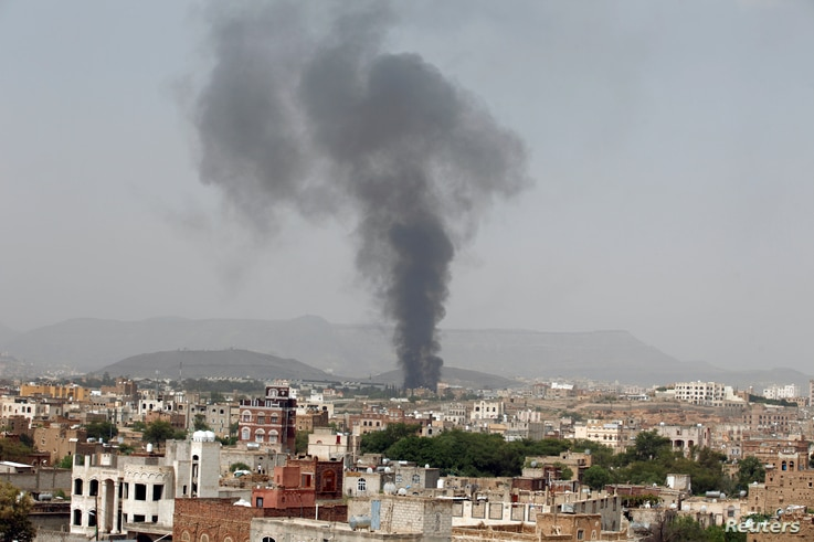 Smoke rises from a snack food factory after a Saudi-led air strike hit it in Sanaa, Yemen