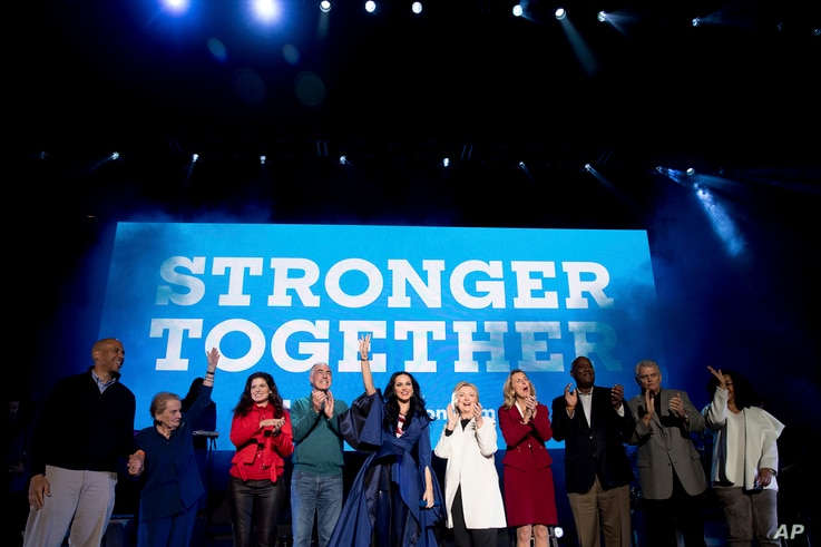 From left, Sen. Cory Booker, D-N.J.; former U.S. Secretary of State Madeleine Albright; actress Debra Messing; Sen. Bob Casey, Jr., D-Pa.; musician Katy Perry; Democratic presidential candidate Hillary Clinton; candidate for U.S. Senate Katie McGinty...