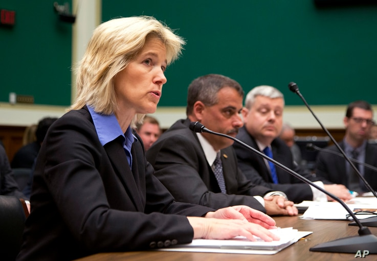 Federal Bureau of Investigation Executive Assistant Director for Science and Technology Amy Hess (L)  testifies on Capitol Hill in Washington, April 19, 2016, before a House Oversight and Investigations subcommittee hearing on deciphering the debate ...