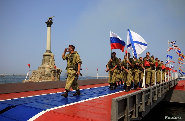 Russian marines parade during the Navy Day celebrations in Sevastopol, Crimea, July 31, 2016.