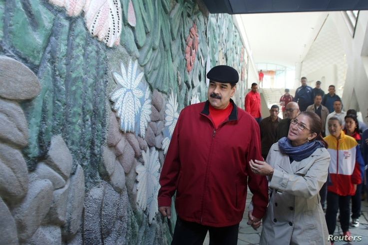 Venezuela's President Nicolas Maduro and his wife, Cilia Flores, inspect the rebuilding of the Humboldt Hotel, a state-run hotel, at the Avila mountain in Caracas, Venezuela, Dec. 7, 2017.