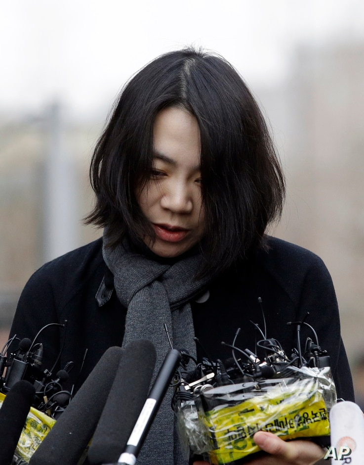 Cho Hyun-ah, Korean Air's former head of cabin service, arrives for questioning at the Ministry of Land, Infrastructure and Transport offices in Seoul, South Korea, Dec. 12, 2014.port in Seoul, South Korea, Dec. 12, 2014.