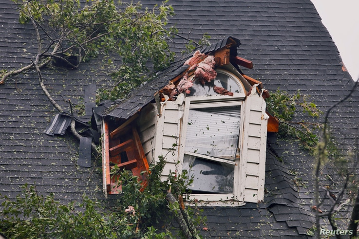 A damaged house is seen after Tropical Storm Florence struck in Winnabow, N.C., Sept. 15, 2018.