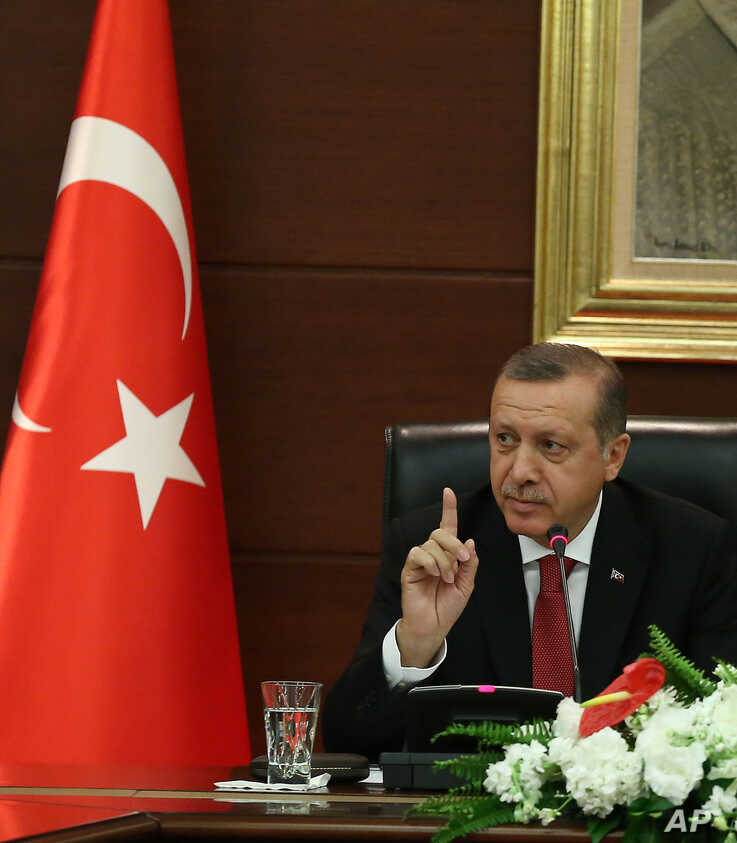 Turkish Prime Minister Recep Tayyip Erdogan speaks to the media in his office in Ankara, Turkey, April 23, 2014.