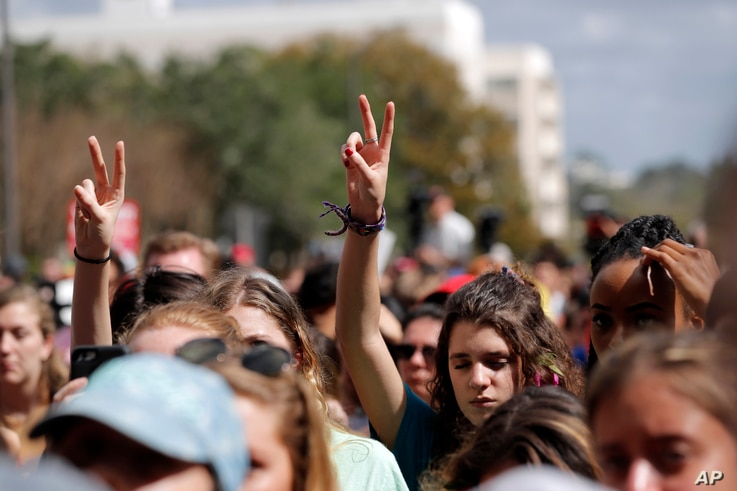 FILE - People participate in a gun control reform rally on the steps of the Capitol in Tallahassee, Fla., Feb. 21, 2018. Students at schools across Broward and Miami-Dade counties in South Florida participated in walkouts one week after the deadly sh...