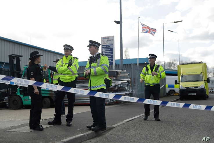 """Police officers secure a cordon outside the vehicle recovery business """"Ashley Wood Recovery"""" in Salisbury, England, March 13, 2018."""