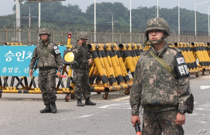 South Korean army soldiers stand guard at Unification Bridge near the border village of Panmunom in Paju, South Korea, Friday, Aug. 21, 2015.