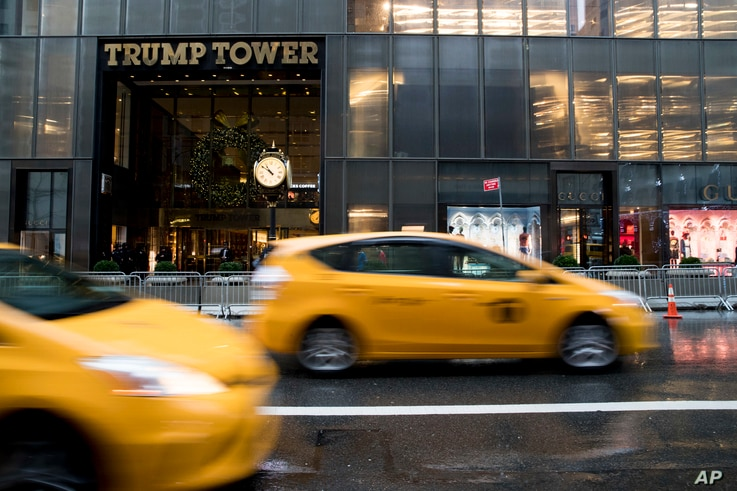 Traffic makes it's way down Fifth Avenue past Trump Tower, Nov. 29, 2016, in New York.