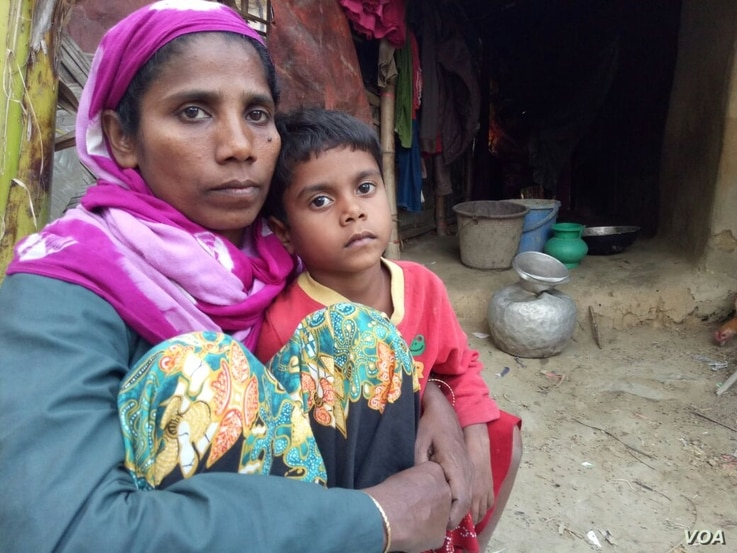 Noor Ayesha, 40, and her daughter at an illegal Rohingya settlement in Bangladesh. The Rohingya woman said that in November in her village in Rakhine, the soldiers burned five of her children to death, raped and killed her two other teenage daughter...