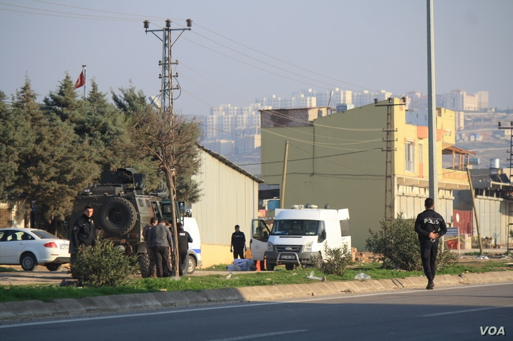 Turkish authorities prepare to detonate an explosive that hit Rehyanli, Turkey on Jan. 31, 2018 and did not immediately explode.