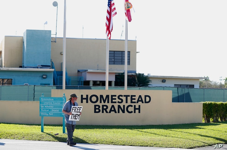 Josh Rubin demonstrates in front of the Homestead Temporary Shelter for Unaccompanied Children in Homestead, Fla., Feb. 19, 2019.