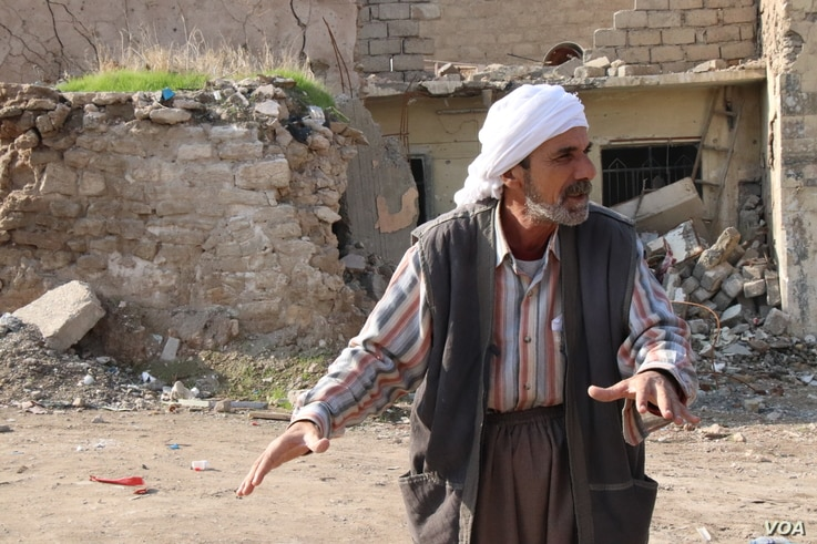 This Mosul resident says his children were killed in the airstrike that destroyed his home more than a year ago, but he has had no help in trying to rebuild, Nov. 21, 2018.  (H.Murdock/VOA)