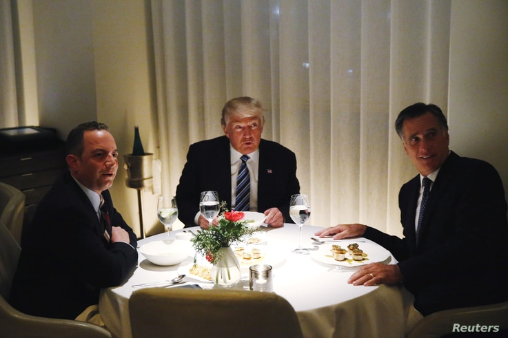 U.S. President-elect Donald Trump sits at a table for dinner with former Massachusetts Governor Mitt Romney (R) and his choice for White House Chief of Staff Reince Priebus (L) at Jean-Georges at the  Trump International Hotel & Tower in New York, No...