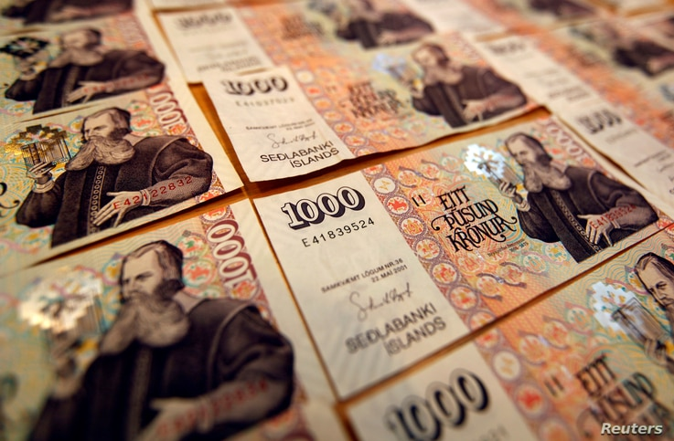 FILE - Icelandic banknotes of one thousand Krona are shown March 23, 2012.