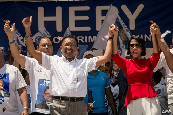 Former Malagasy President and presidential candidate Hery Rajaonarimampianina and and his wife Voahangy Rajaonarimampianina attend a campaign rally, Nov. 4, 2018, at the Colyseum stadium in Antananarivo.
