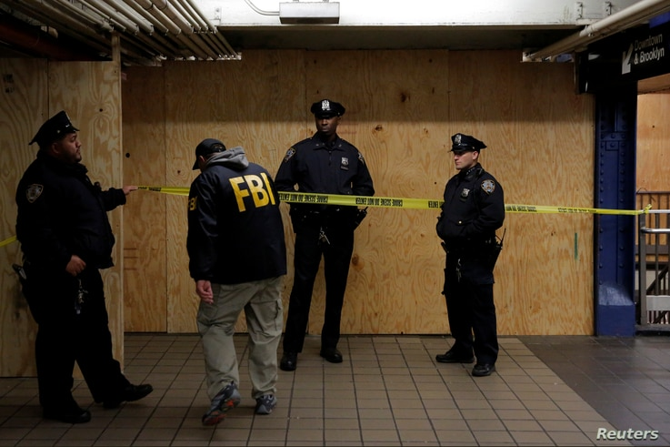 A member of the FBI enters the crime scene beneath the New York Port Authority Bus Terminal following an attempted detonation during the morning rush hour, in New York City, New York, Dec. 11, 2017.