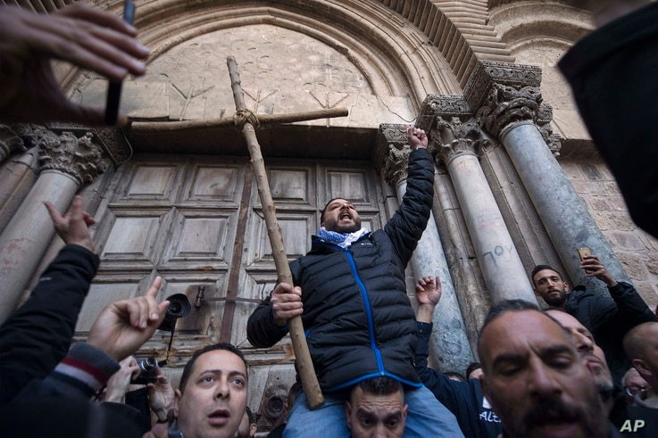 Demonstrators protest outside the closed doors of the Church of the Holy Sepulchre, traditionally believed by many Christians to be the site of the crucifixion and burial of Jesus Christ, in Jerusalem, Feb. 27, 2018.