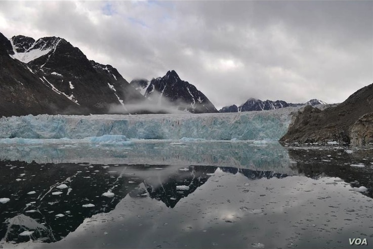 Glaciers on western Svalbard have been retreating for at least the past 100 years. The lake in the foreground can be used to study past changes in glacier activity. (Credit: William D'Andrea)