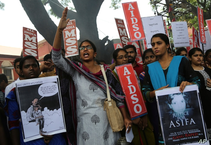 A member of a students organization shouts slogans as others carry placards asking justice for Asifa, an  8-year-old girl who was raped and murdered, during a protest in Bangalore, India, Friday, April 13, 2018. Thousands of members of a radical Hind...