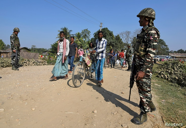 Central Reserve Police Force personnel patrolling ahead of the publication of the first draft of the National Register of Citizens  in Juria village in the northeastern state of Assam, India, December 28, 2017.