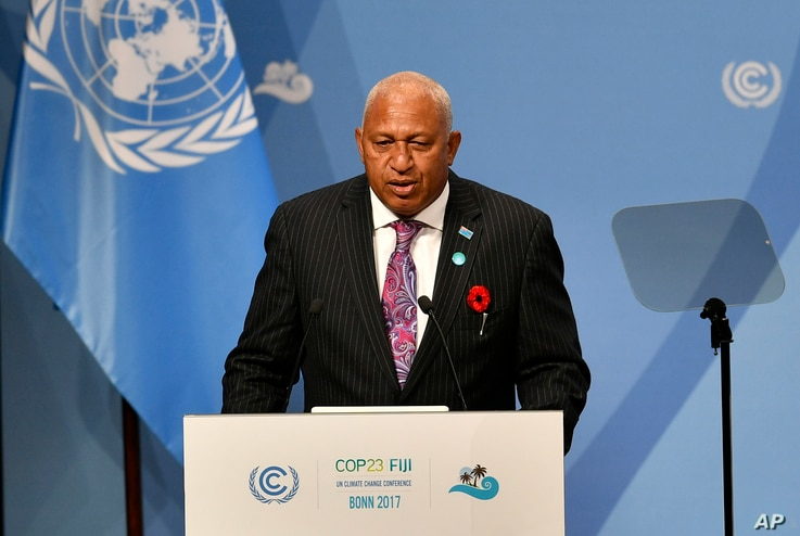 Fiji's Prime Minister Frank Bainimarama talks at the opening of the UN Climate Change Conference in Bonn, Germany, Nov. 6, 2017.