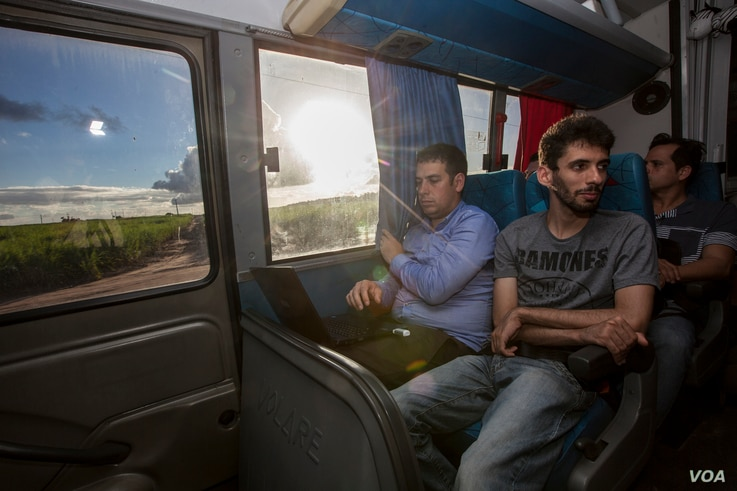 Dr. Nick Loman, left, and members of the ZIBRA team are seen travelling from Natal to Joao Pessoa in north-east Brazil on the lab-equipped minibus. (Courtesy - Ricardo Funari)