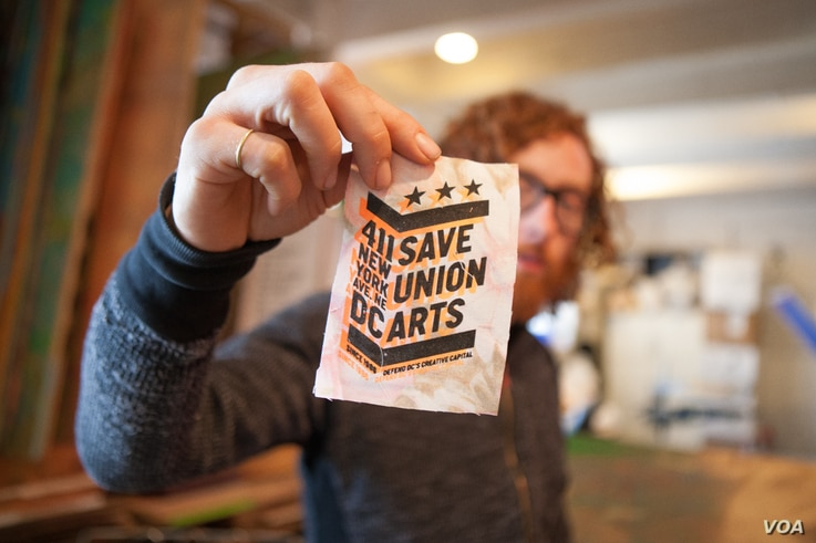 Visual artist and resident at Union Arts D.C. Graham Boyle is part of the movement to prevent the loss of Union Arts as low-cost studio and performance space for young artists, April 3, 2016. (A. Hernandez/VOA)