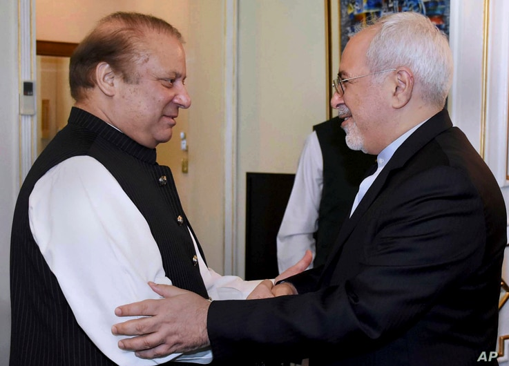 Visiting Iranian Foreign Minister Mohammad Javad Zarif, right, shakes hand with Pakistani Prime Minister Nawaz Sharif prior to their meeting in Islamabad, May 3, 2017. Pakistan recently said that it has reached an agreement with Iran to strengthen se...