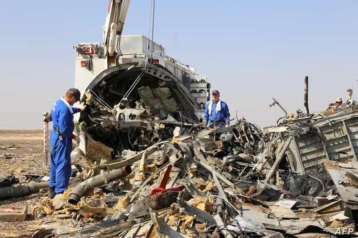Russian emergency services personnel working at the crash site of a A321 Russian airliner in Wadi al-Zolomat, a mountainous area of Egypt's Sinai Peninsula. (Russian Emergency Ministry Handout photo)