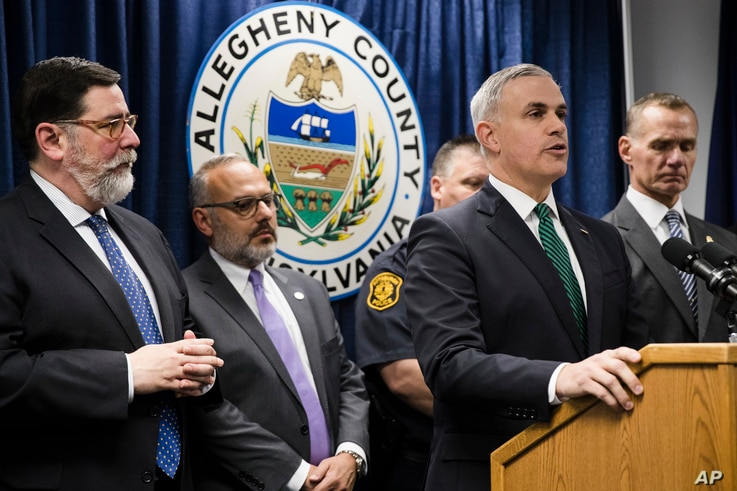 United States Attorney Scott Brady, at podium, speaks with members of the media during a news conference in the aftermath of a deadly shooting at the Tree of Life Synagogue in Pittsburgh, Oct. 28, 2018.