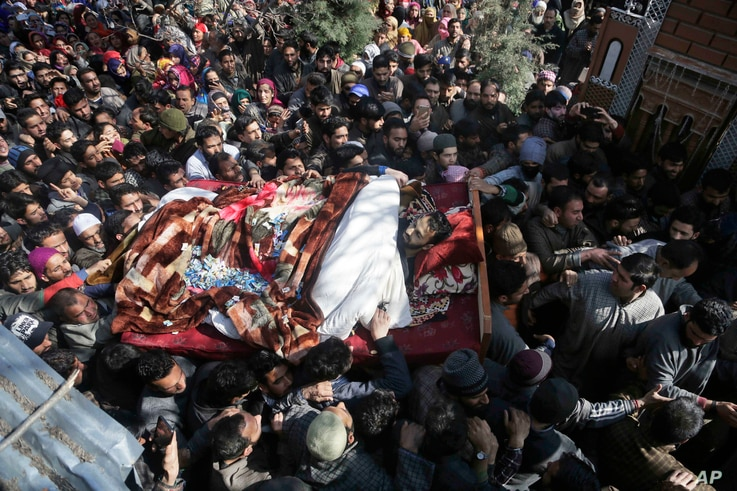 Kashmiri villagers shout slogans as they carry the body of a civilian Suhail Ahmad during his funeral at Pinjura village 52 kilometers south of Srinagar, Indian controlled Kashmir, March 5, 2018.