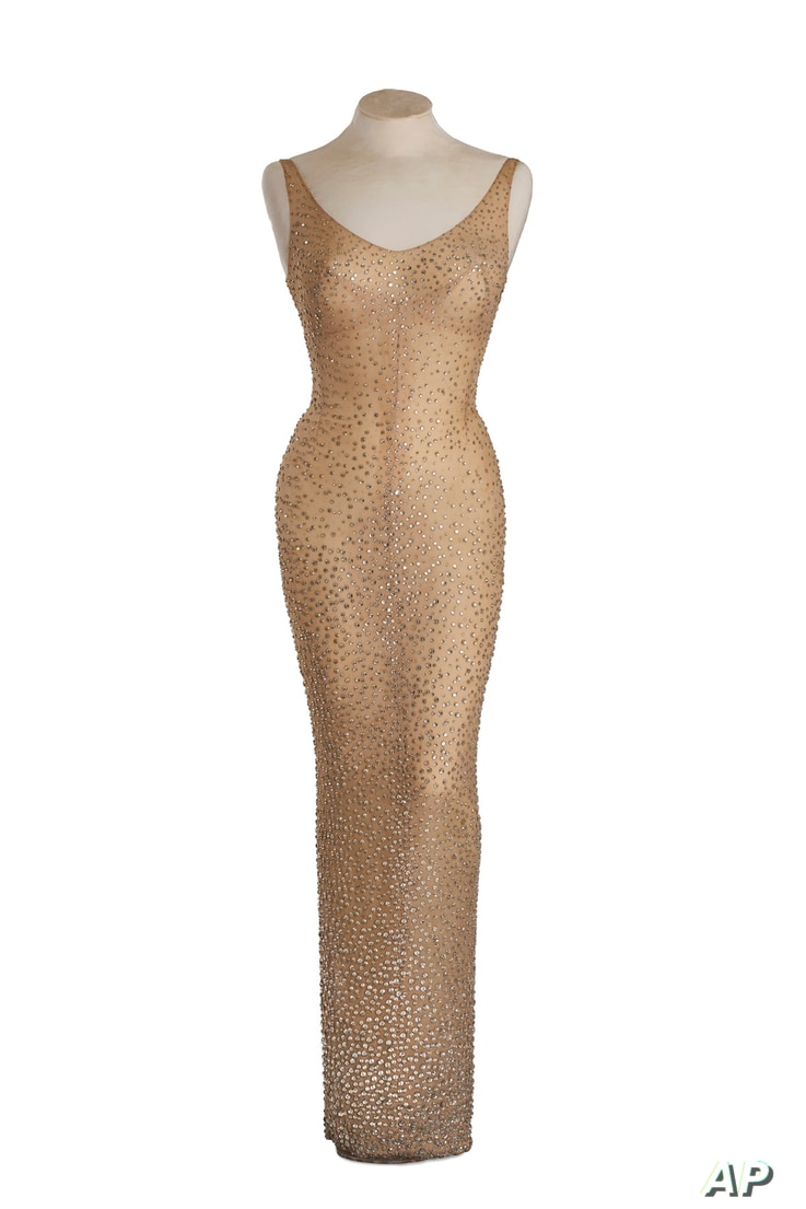 Marilyn Monroe had to be sewn into the form-fitting gown. (Julien's Auctions via AP)