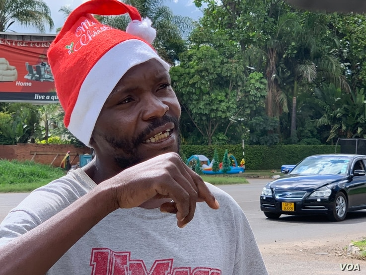 Forty-year-old Clive Mushayi became a street vendor four years ago after losing his job as an automobile mechanic. He says he cannot afford to go to his rural home east of Harare to be with his relatives this Christmas, Dec. 23, 2018. (C. Mavhunga fo...